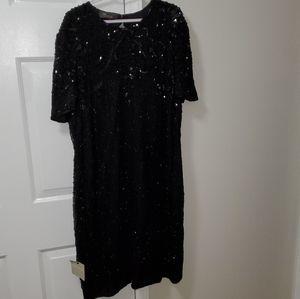 Gorgeous, classic and beaded midi dress.